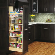 View of kitchen organisation products by Rev-A-Shelf, including cabinetry, countertop, floor, flooring, hardwood, kitchen, laminate flooring, refrigerator, wood flooring, black