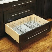 View of kitchen organisation products by Rev-A-Shelf, including countertop, drawer, floor, flooring, furniture, hardwood, kitchen, kitchen stove, table, wood stain, brown, black
