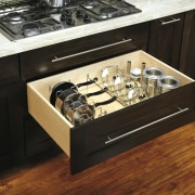 View of kitchen organisation products by Rev-A-Shelf, including countertop, drawer, furniture, gas stove, home appliance, kitchen, kitchen appliance, kitchen stove, table, black