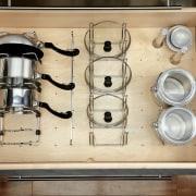 View of kitchen organisation products by Rev-A-Shelf, including furniture, kitchen organizer, orange, brown