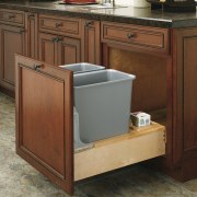 View of kitchen organisation products by Rev-A-Shelf, including cabinetry, countertop, drawer, floor, flooring, furniture, hardwood, home appliance, kitchen, sink, wood stain, brown