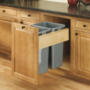 View of kitchen organisation products by Rev-A-Shelf, including cabinetry, countertop, cuisine classique, desk, drawer, floor, flooring, furniture, hardwood, kitchen, laminate flooring, plywood, product, wood, wood flooring, wood stain, orange