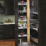 View of kitchen organisation products by Rev-A-Shelf, including cabinetry, closet, countertop, display case, furniture, kitchen, kitchen appliance, refrigerator, shelf, shelving, black