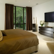View of bedroom with brown bedspread, cream carpeting bed frame, bedroom, interior design, property, real estate, room, suite, window, brown, gray