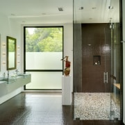 View of bathroom with brown wall and floor bathroom, door, floor, flooring, interior design, room, gray