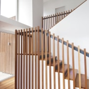 VIew of stairway in contemporary home. - VIew baluster, floor, flooring, handrail, hardwood, interior design, laminate flooring, product, stairs, wood, wood flooring, wood stain, white