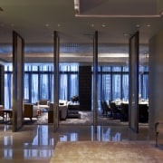 View of open plan area in a contemporary apartment, ceiling, interior design, living room, lobby, real estate, black