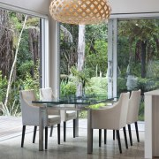 View of dining area with decorative light feature. chair, dining room, furniture, home, interior design, outdoor structure, patio, table, window, gray
