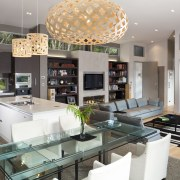 View of open plan dining, lounge and kitchen interior design, kitchen, living room, gray