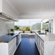 Carrara marble is used to create a centerpiece architecture, countertop, daylighting, estate, home, house, interior design, kitchen, property, real estate, gray