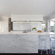 Carrara marble is used to create a centerpiece architecture, ceiling, countertop, floor, home, house, interior design, kitchen, real estate, gray