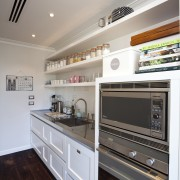 The kitchen is designed by Robyn Labb Kitchens. cabinetry, countertop, cuisine classique, floor, home appliance, interior design, kitchen, kitchen appliance, major appliance, room, gray