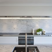 The kitchen is designed by Robyn Labb Kitchens. floor, furniture, home, house, interior design, table, gray