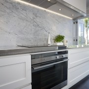 The kitchen is designed by Robyn Labb Kitchens. cabinetry, countertop, floor, interior design, kitchen, wall, gray