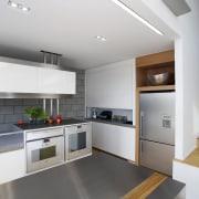 This kitchen features stainless steel benchtops. It was countertop, floor, interior design, kitchen, white, gray