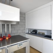 This kitchen features stainless steel benchtops. It was cabinetry, countertop, cuisine classique, floor, home appliance, interior design, kitchen, kitchen appliance, kitchen stove, room, gray