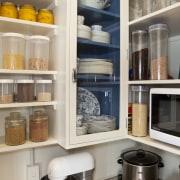 Interior Designer and Kitchen Designer Celia Visser. Modern cabinetry, countertop, furniture, home appliance, interior design, kitchen, kitchen organizer, major appliance, refrigerator, room, shelf, shelving, gray