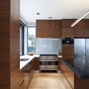 Designer Shane George. Open-plan space. Small amount of architecture, cabinetry, countertop, cuisine classique, floor, hardwood, house, interior design, kitchen, laminate flooring, real estate, room, wood, wood flooring, white, brown
