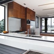 Designer Shane George. Open-plan space. Small amount of countertop, interior design, kitchen, white