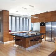 Designer Shane George. Open-plan space. Small amount of cabinetry, countertop, floor, flooring, hardwood, interior design, kitchen, real estate, room, wood, wood flooring, white