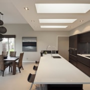 View of contemporary open plan interior with neutral-toned ceiling, dining room, house, interior design, kitchen, living room, property, real estate, room, gray