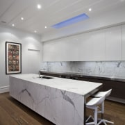 Designed by Morgan Cronin of Cronin Kitchens, this architecture, ceiling, floor, flooring, furniture, interior design, product design, table, wall, gray