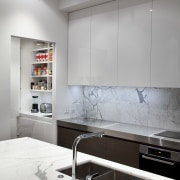 Designed by Morgan Cronin of Cronin Kitchens, this countertop, floor, interior design, kitchen, room, wall, gray