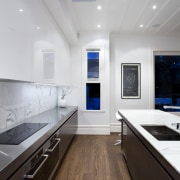 Designed by Morgan Cronin of Cronin Kitchens, this architecture, ceiling, countertop, daylighting, floor, interior design, kitchen, room, wood flooring, gray