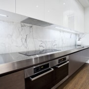 Designed by Morgan Cronin of Cronin Kitchens, this architecture, cabinetry, countertop, floor, flooring, glass, interior design, kitchen, product design, wall, wood flooring, white