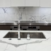 Designed by Morgan Cronin of Cronin Kitchens, this bathroom sink, countertop, floor, furniture, interior design, kitchen, product design, sink, table, tap, tile, white, gray