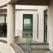 View of home with curved, toughened glass balustrade. architecture, ceiling, daylighting, floor, glass, handrail, interior design, window, white, gray