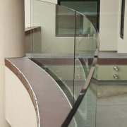View of home with curved, toughened glass balustrade. architecture, floor, furniture, glass, handrail, product design, stairs, table, gray