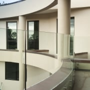 View of home with curved, toughened glass balustrade. architecture, glass, interior design, white