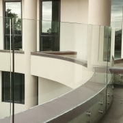 View of home with curved, toughened glass balustrade. architecture, floor, furniture, glass, handrail, interior design, stairs, white