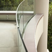 View of home with curved, toughened glass balustrade. architecture, glass, handrail, stairs, gray, brown