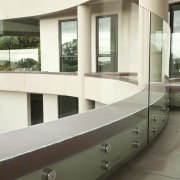 View of home with curved, toughened glass balustrade. architecture, glass, window, white, brown