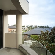 View of home with curved, toughened glass balustrade. apartment, architecture, balcony, building, condominium, daylighting, estate, house, property, real estate, sky, white