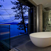 This master suite makes use of the sea architecture, bathroom, estate, home, house, interior design, property, room, window, blue