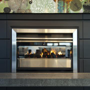 View of dark-toned indoor fireplace. - View of black