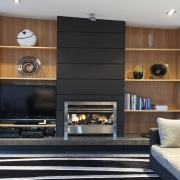 View of dark-toned indoor fireplace. - View of fireplace, hearth, interior design, living room, black