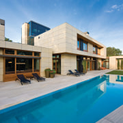 View of pool area. - View of pool architecture, estate, facade, home, house, property, real estate, residential area, swimming pool, villa, teal, gray
