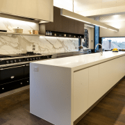 Stainless steel appliances. Minimalistic design. Indoor- outdoor flow. cabinetry, countertop, cuisine classique, floor, flooring, interior design, kitchen, brown