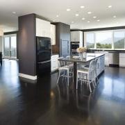 Euro style cabinetry doors. Dark quartzite counter tops. countertop, floor, flooring, hardwood, interior design, kitchen, real estate, room, wood flooring, white, black