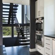 Euro style cabinetry doors. Dark quartzite counter tops. floor, home appliance, interior design, black, gray
