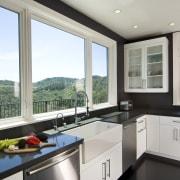 Euro style cabinetry doors. Dark quartzite counter tops. countertop, interior design, kitchen, property, real estate, window, gray