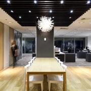 Natural materials are used throughout the design. Oak ceiling, flooring, interior design, lobby, black, orange