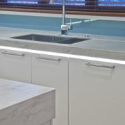 Designer Mal Corby. Corian Clam Shell bench top. countertop, floor, kitchen, sink, tap, gray
