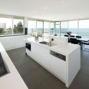 View of kitchen and dining area  designed floor, interior design, kitchen, real estate, white