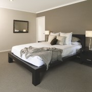 This show home was designed by Platinum Homes bed, bed frame, bedroom, floor, flooring, furniture, interior design, mattress, property, real estate, room, wood, white, gray, brown