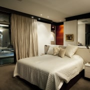 This house was designed by architect Martin Grounds bedroom, ceiling, hotel, interior design, room, suite, brown